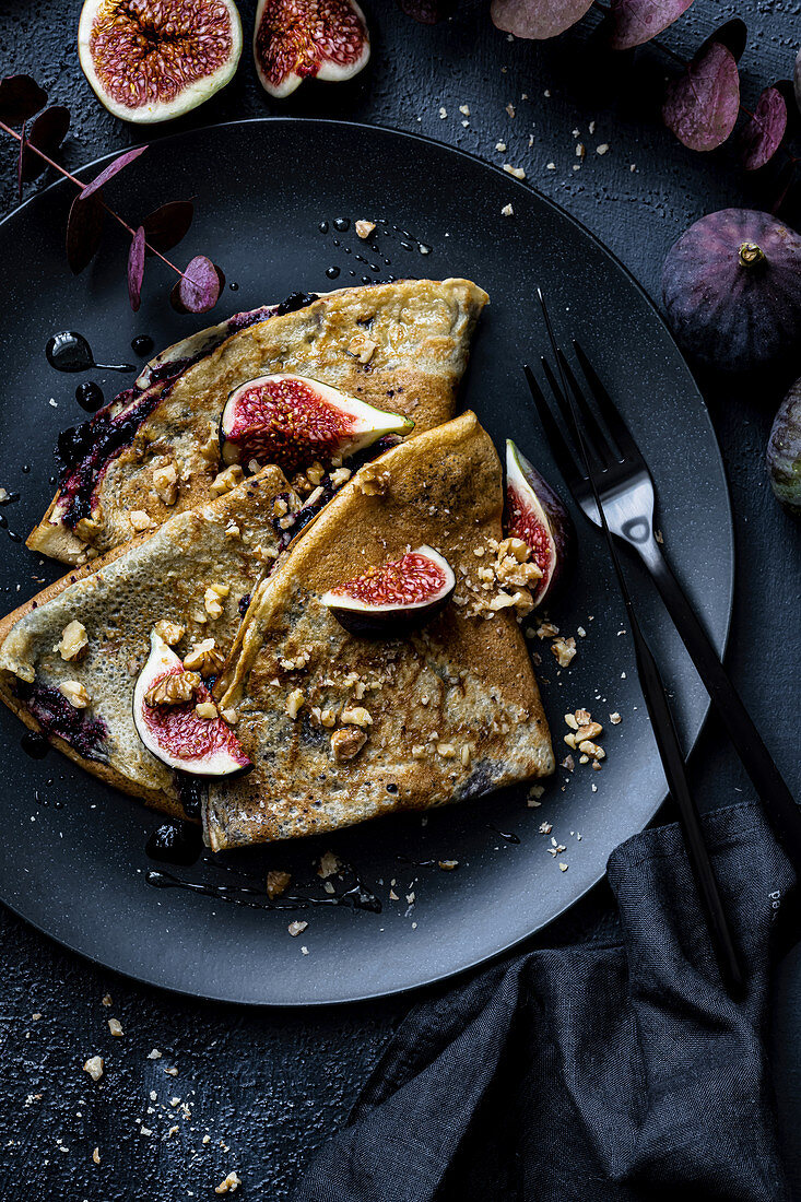 Crepes with wildberry jam figs and crushed walnuts