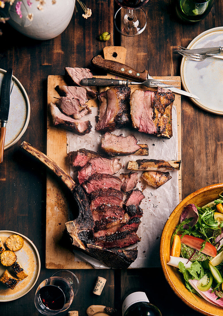 Sliced, grilled tomahawk steak and spare ribs