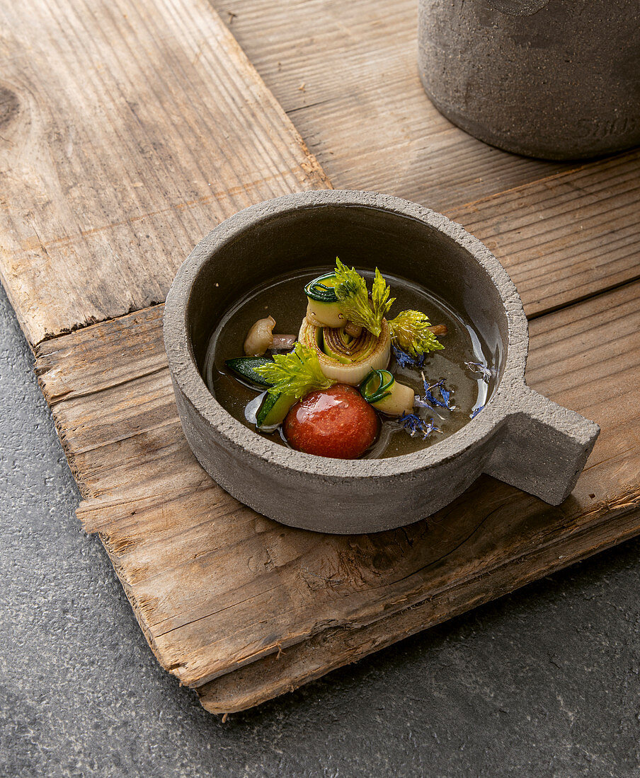 Celery tea with cornflower, olive oil and grilled leek