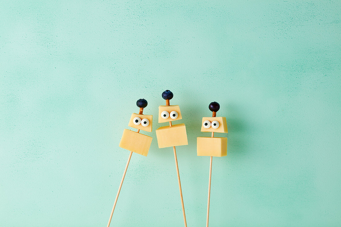 Cheese robots on sticks with blueberries