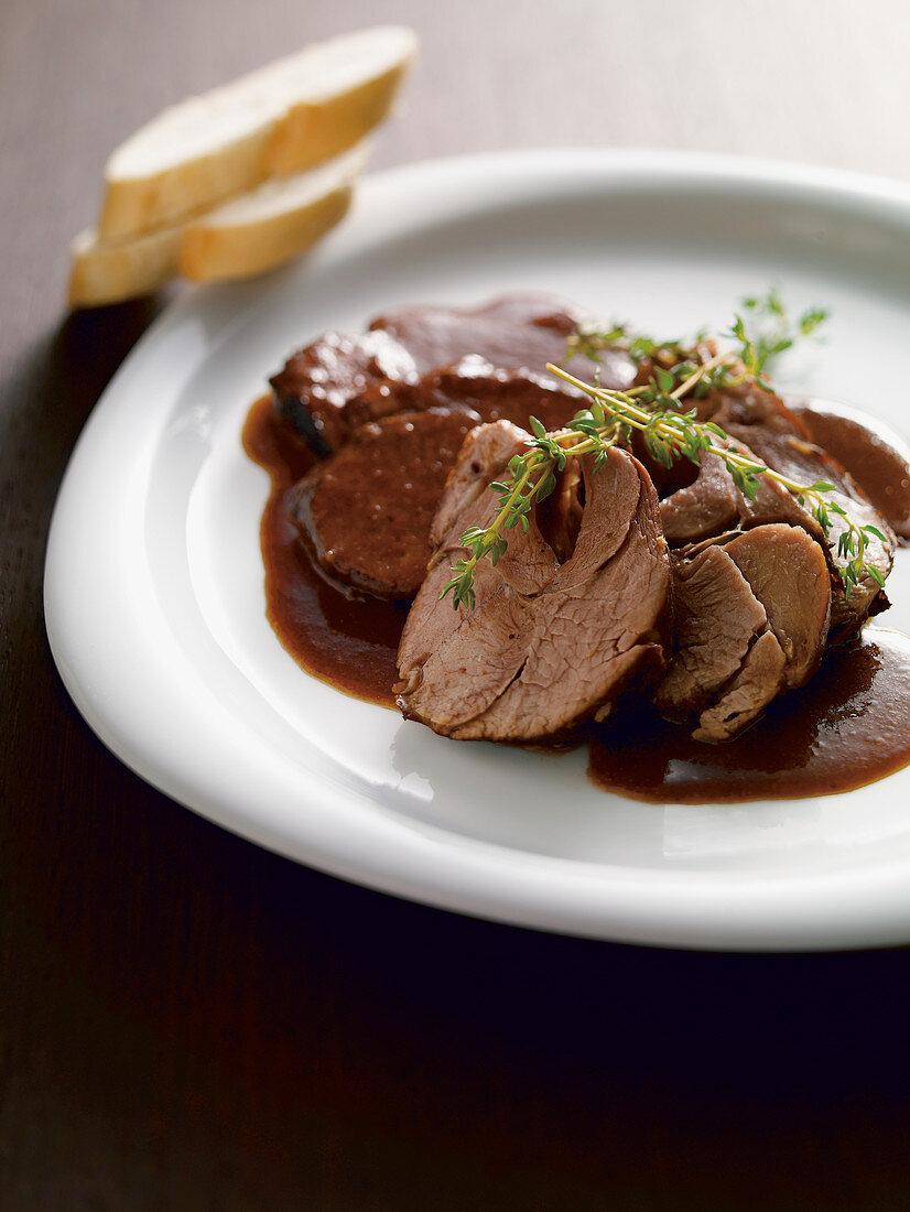 Palatinate-style roast lamb cooked on hay