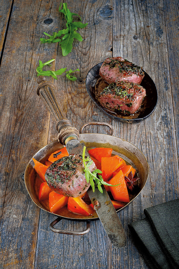Deer medallions with a herb crust and spiced pumpkin