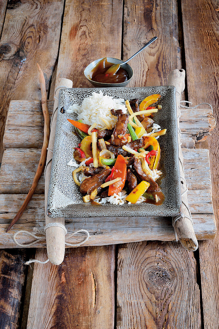 Fried strips of beef with vegetables in hoisin sauce