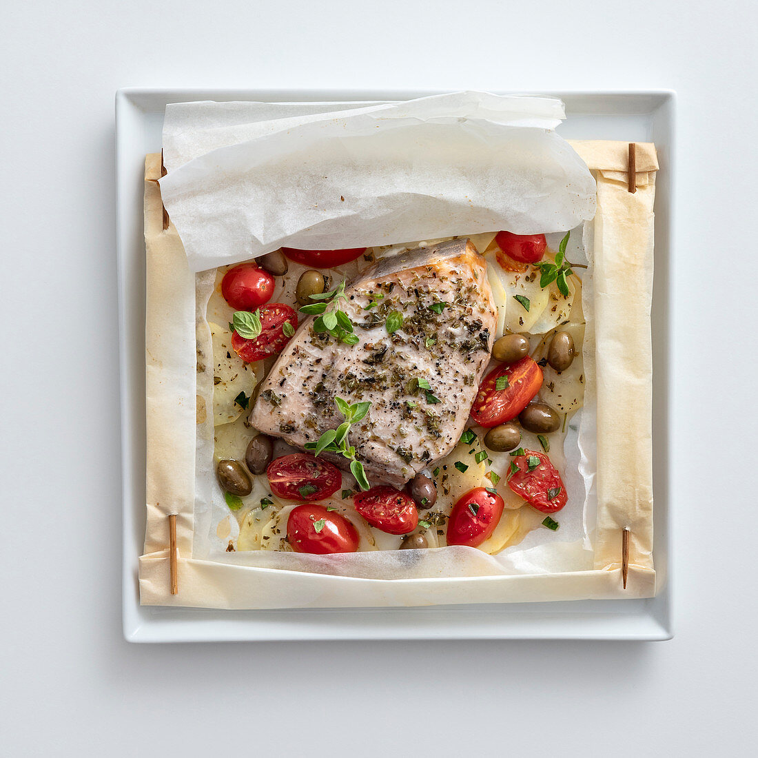 Swordfish with potatoes, date tomatoes and olives