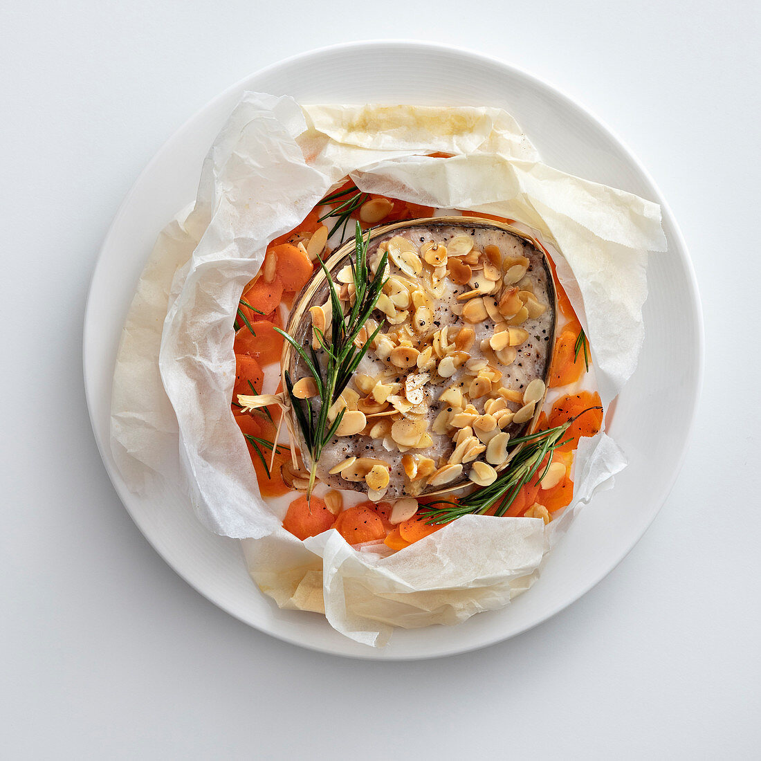 Amberjack with almonds and roasted garlic