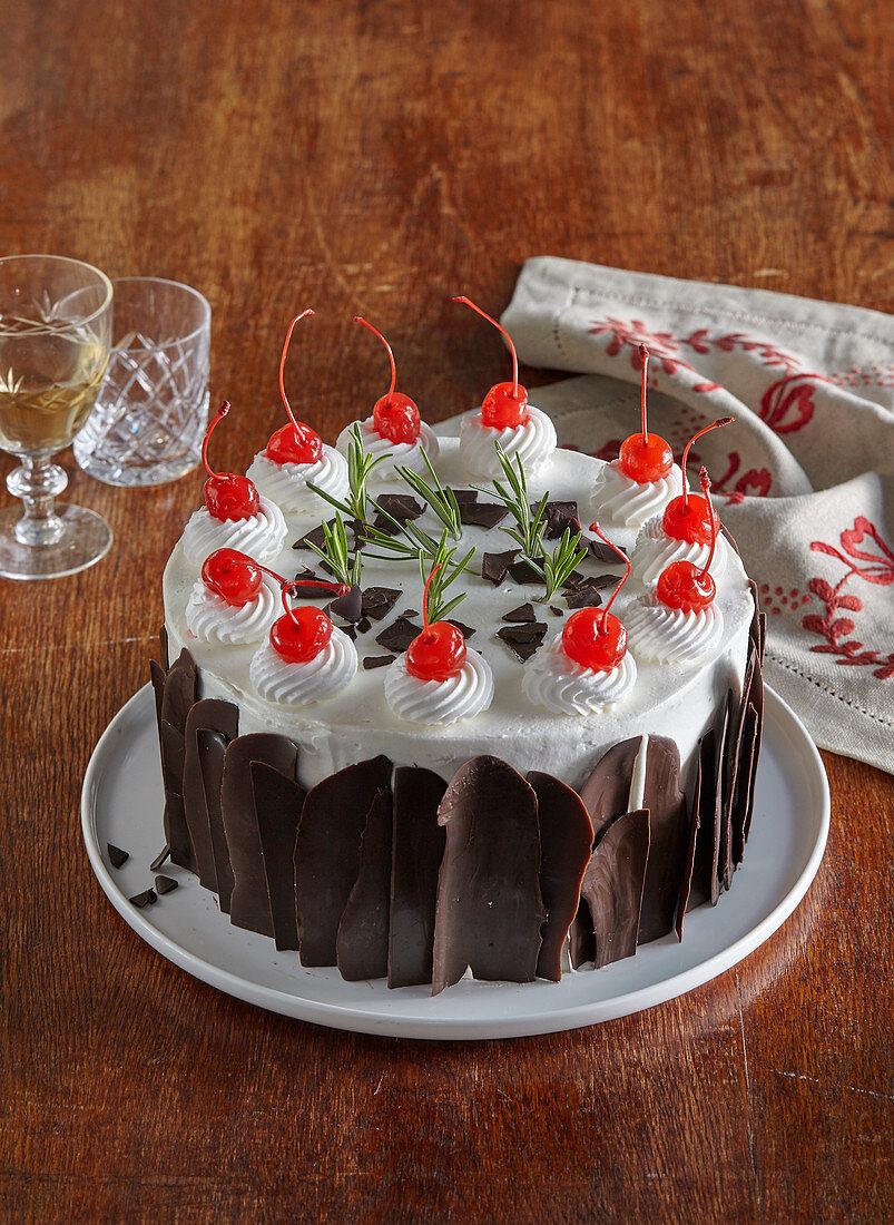 Cake with chocolate and cherries