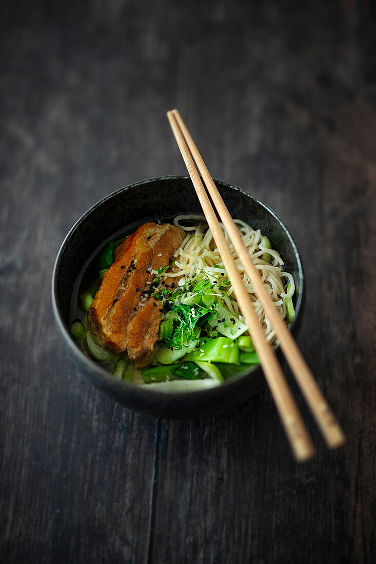 Ramen soup with marinated ribs, bok choy and noodles