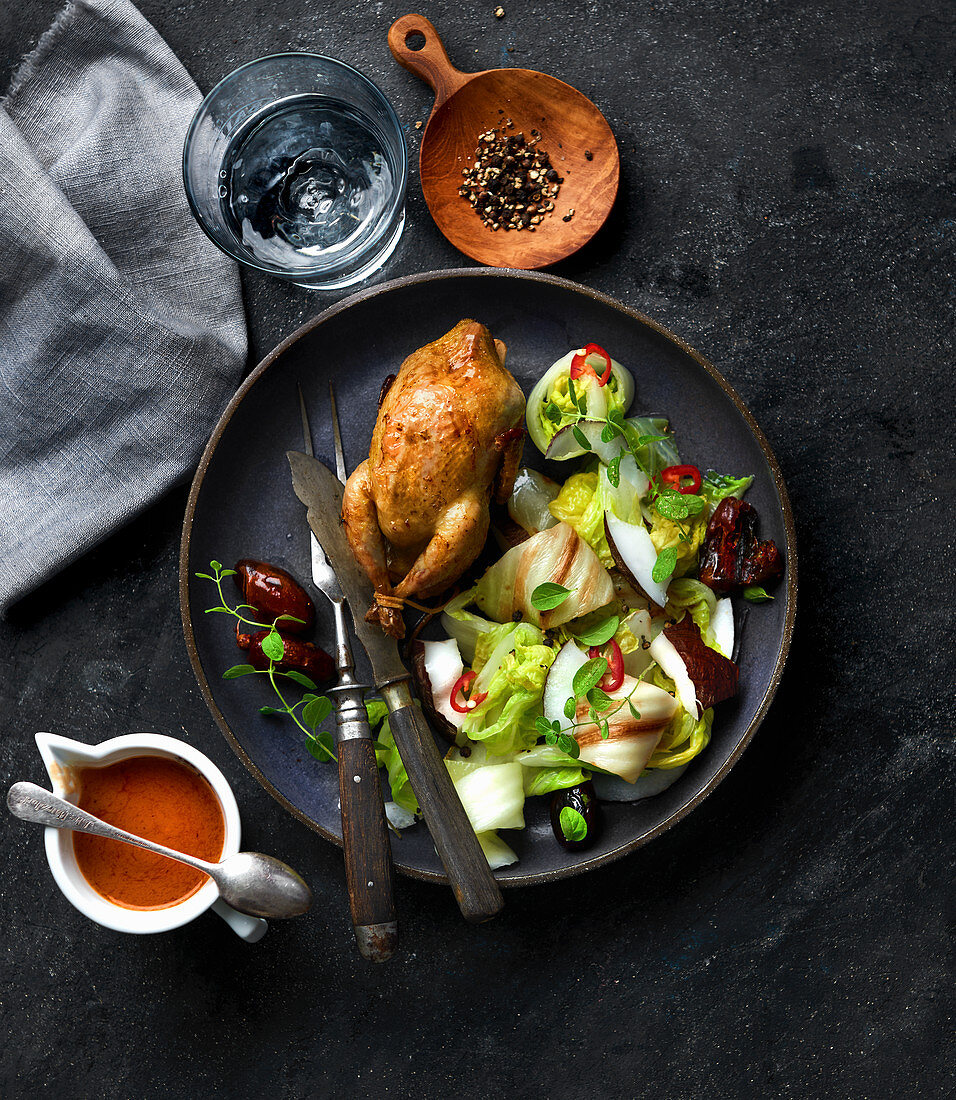 Roasted quail with Chinese cabbage, coconut, dates and chili salad