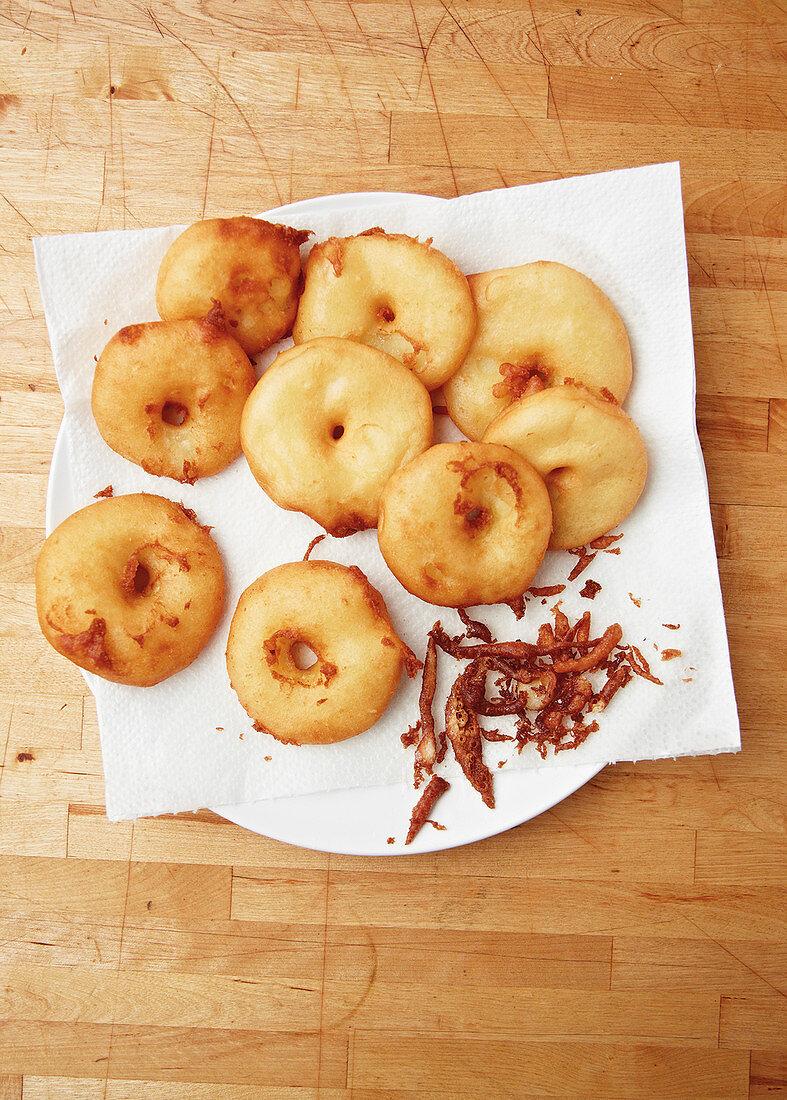 Apple beignets on kitchen paper