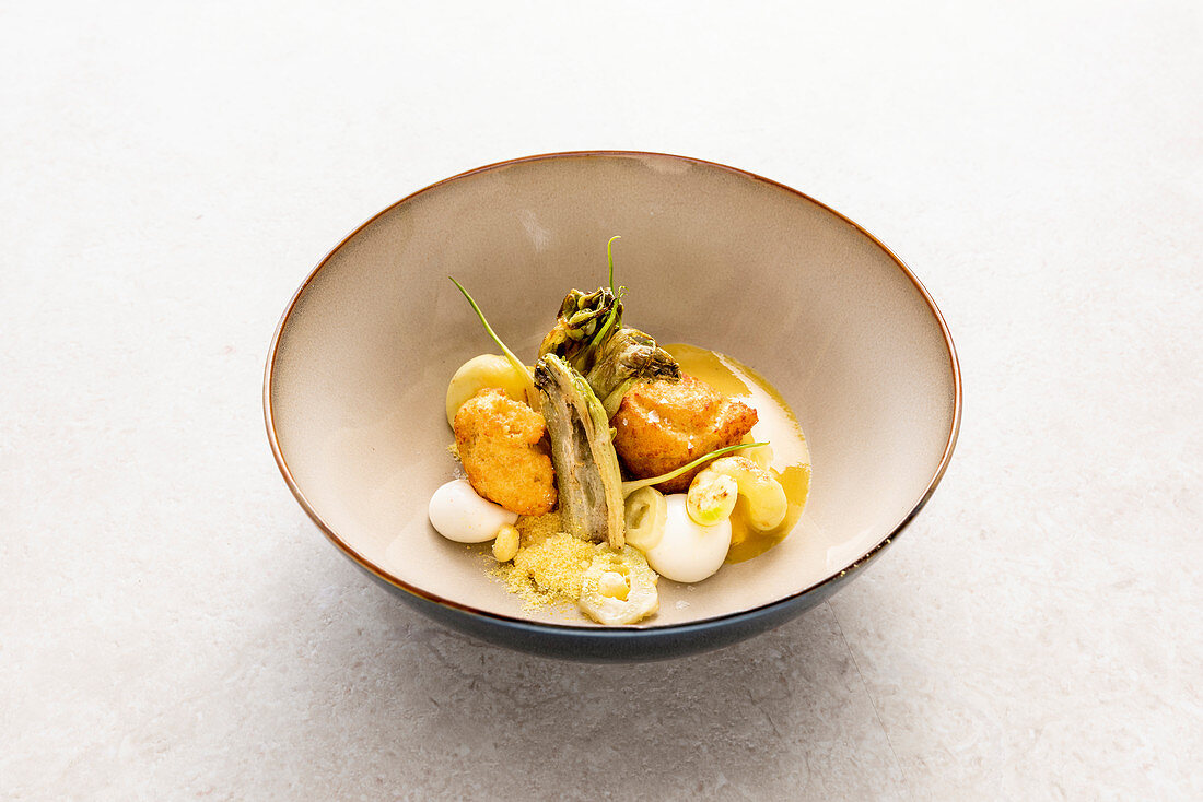Sweetcorn beignet with puntarelle, wild thyme honey and thyme sheep's cheese dumplings