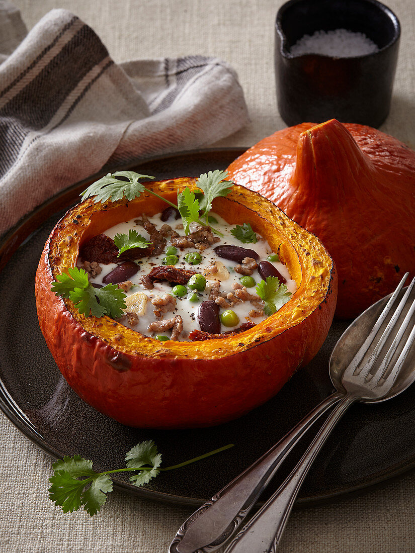Pumpkin stuffed with meat, beans and sun-dried tomatoes