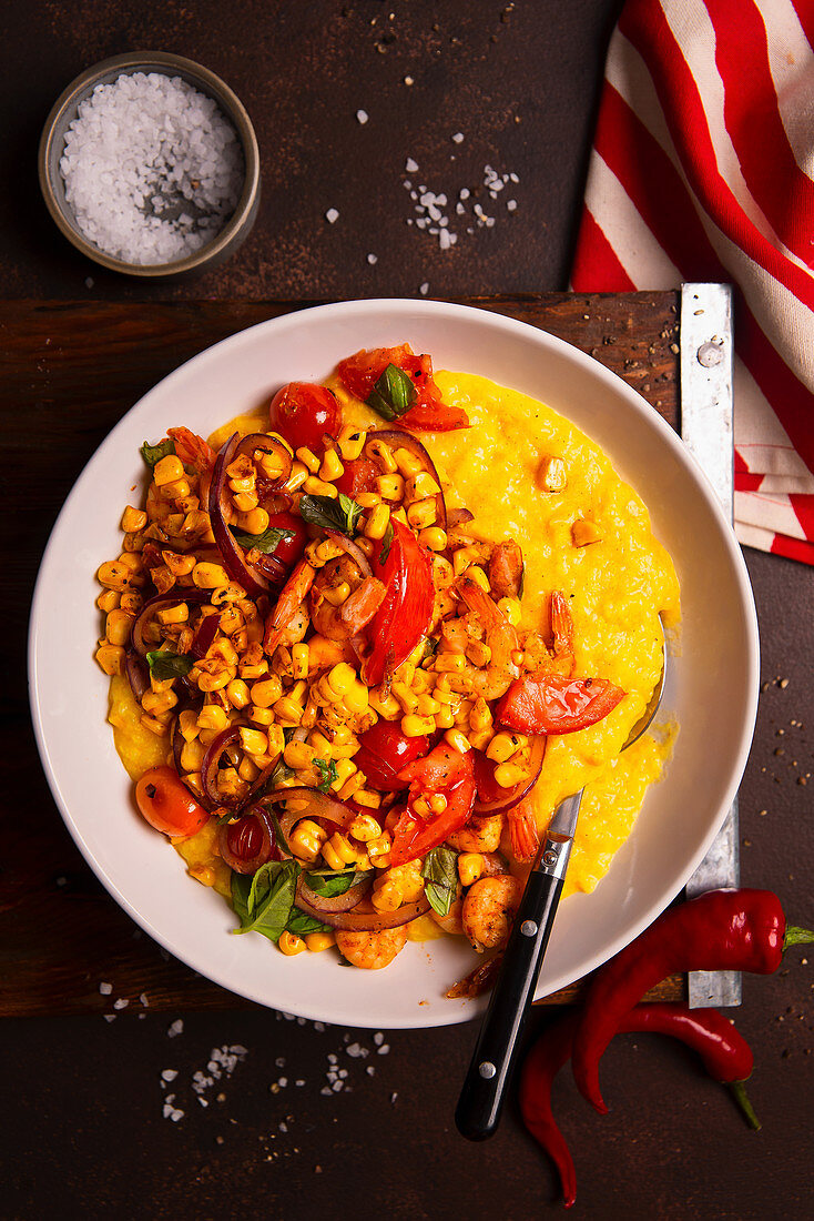 Chinese rice congee with sweetcorn, tomatoes and shrimps