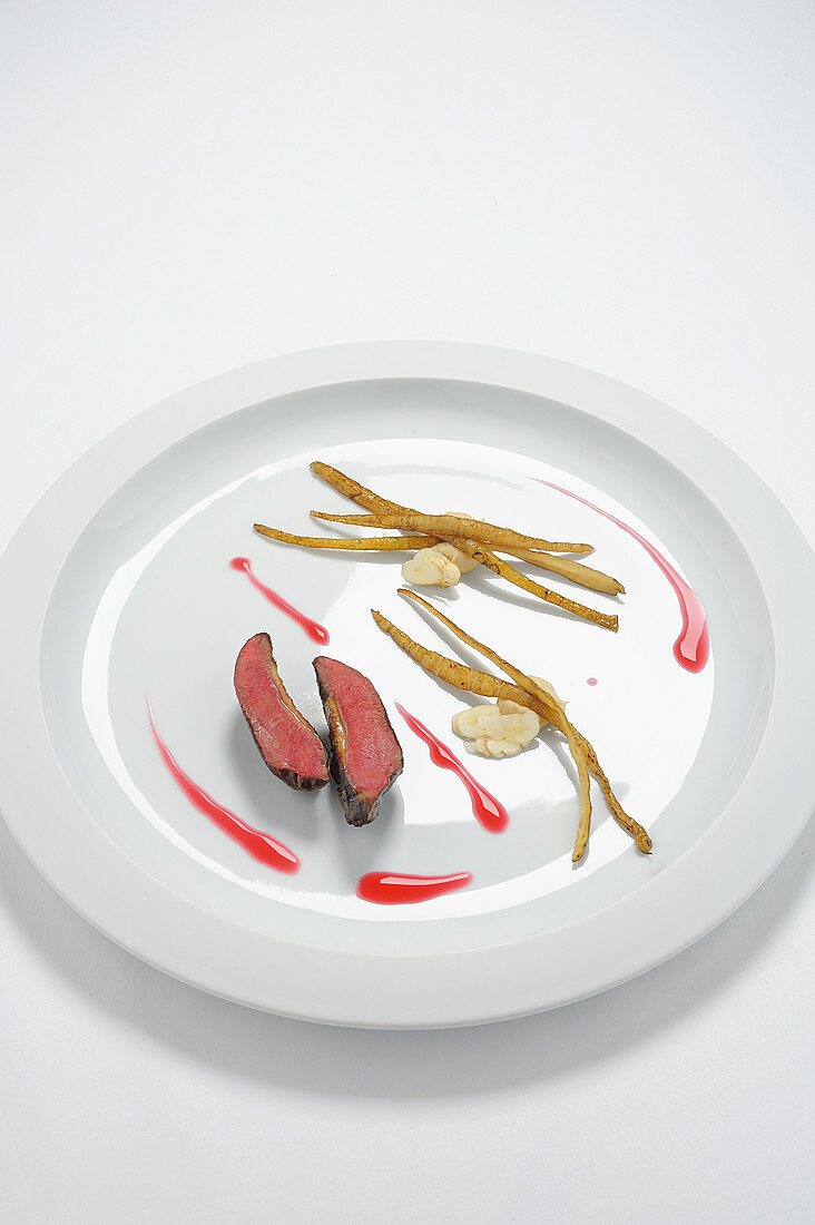 Pigeon breast with sugar roots and lingonberry jus