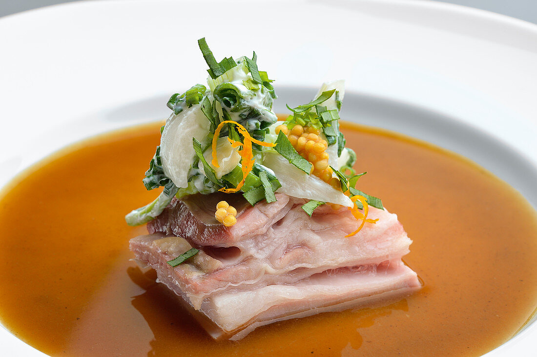 Lamb belly with onion salad and brown onion broth