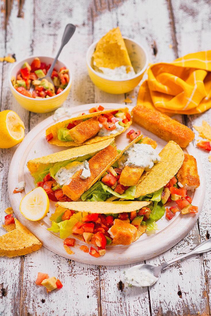 Tacos with halloumi sticks, tomatos, avocado, lettuce and tzatziki sauce