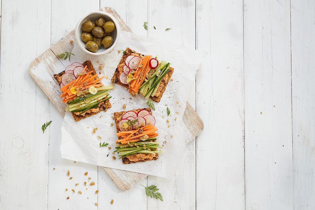 Vegetable crackers with a carrot spread and julienned vegetables