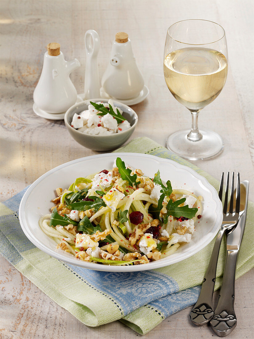 Kohlrabi and apple spiral salad with goat's cheese and cranberries