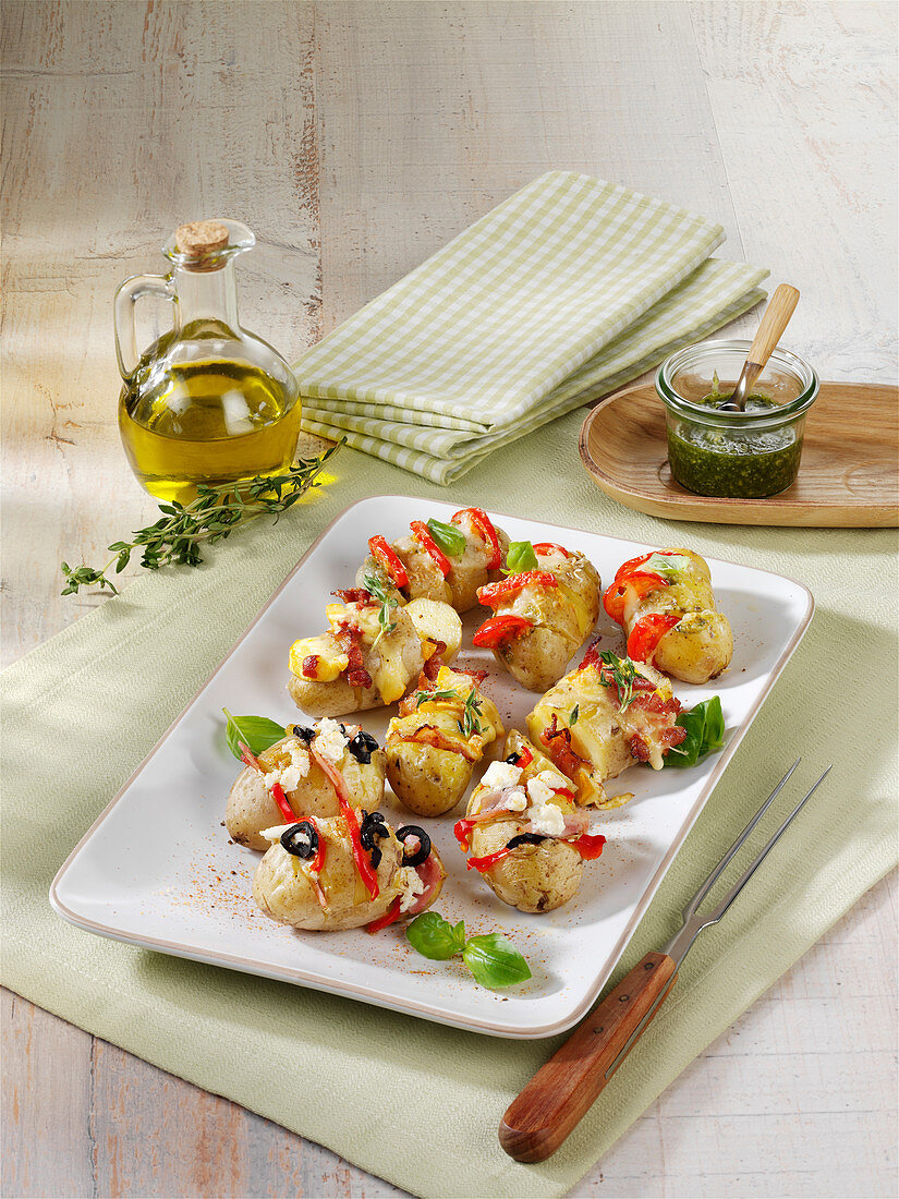 New potatoes filled with cheese, ham and olives