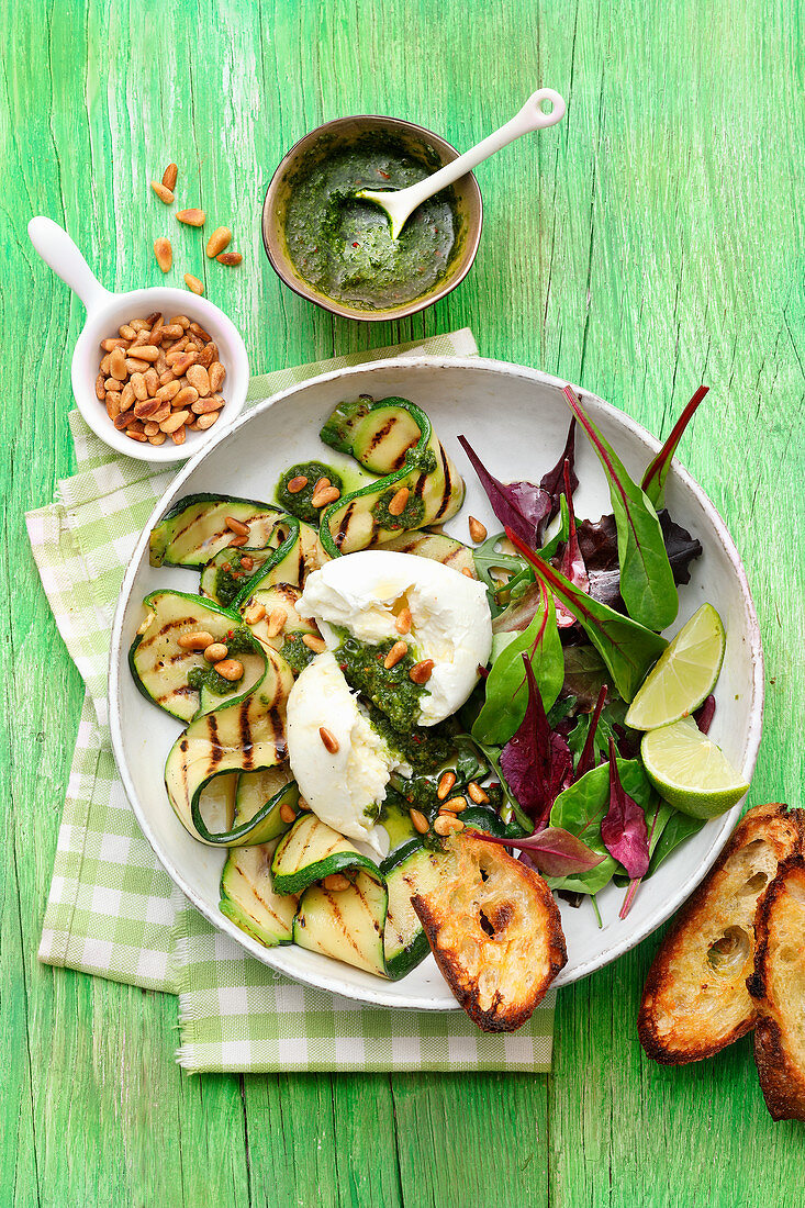 Grilled zucchini with mozzarella and young Swiss chard and pine nuts