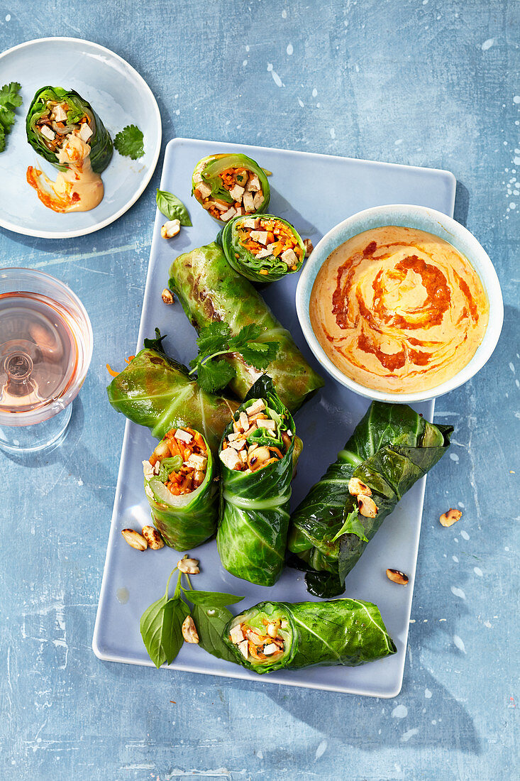 Stuffed cabbage roulade with a coconut and peanut dip