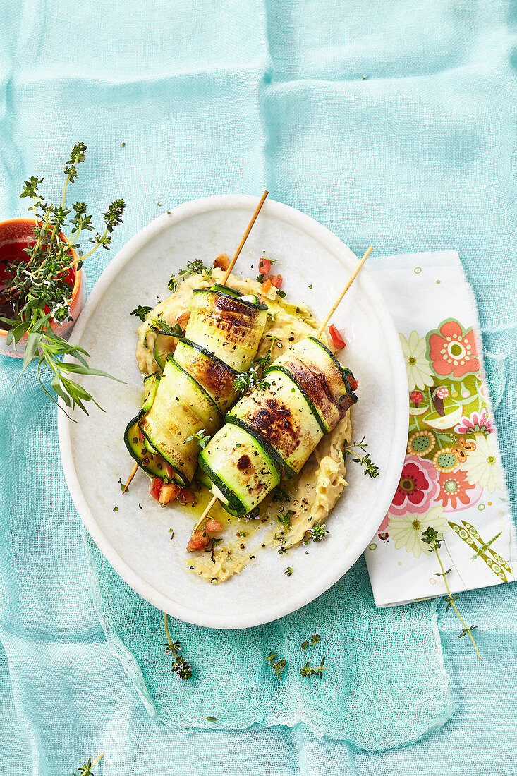 Fried courgette rolls with bean purée
