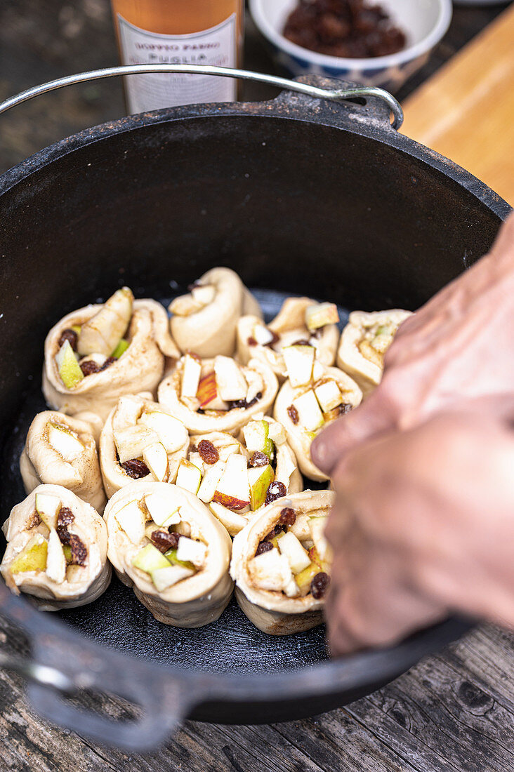 Preparing cinnamon buns for the Dutch oven