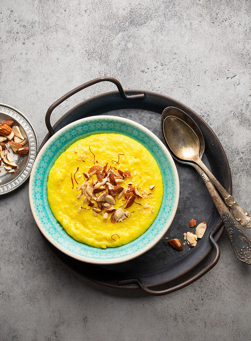 Traditional Indian kheer (Sweet rice milk pudding with almonds and saffron)