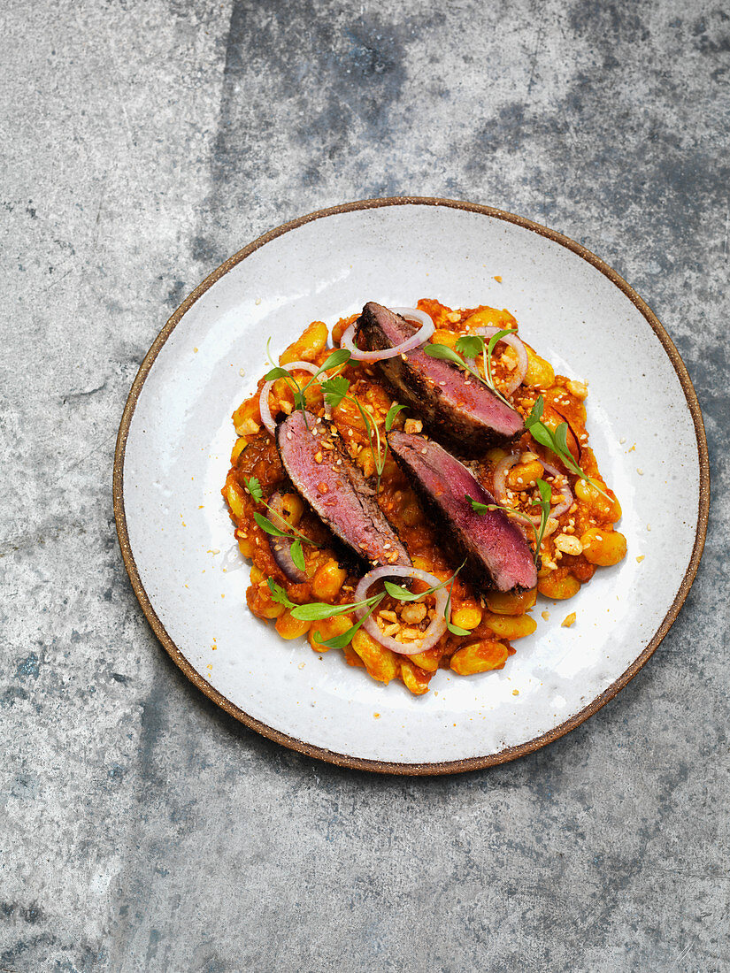 Grouse with cannellini in tomato sauce