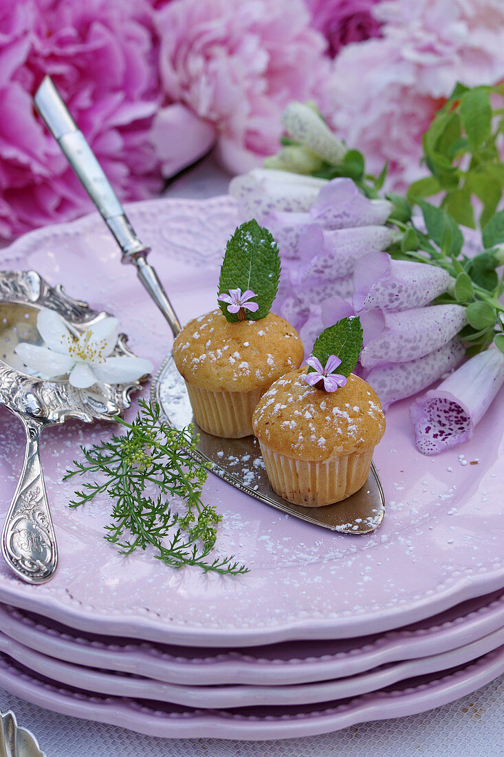 Vanilla muffins with mint leaves
