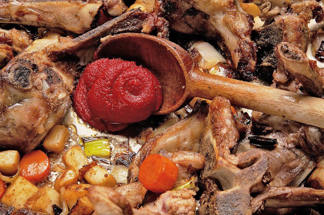 Tomato sauce added to dark gravy ingredients