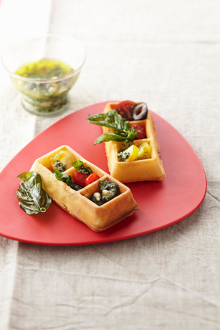 Waffles with tomatoes and pesto