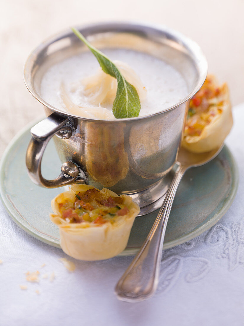 White onion soup with mini strudels
