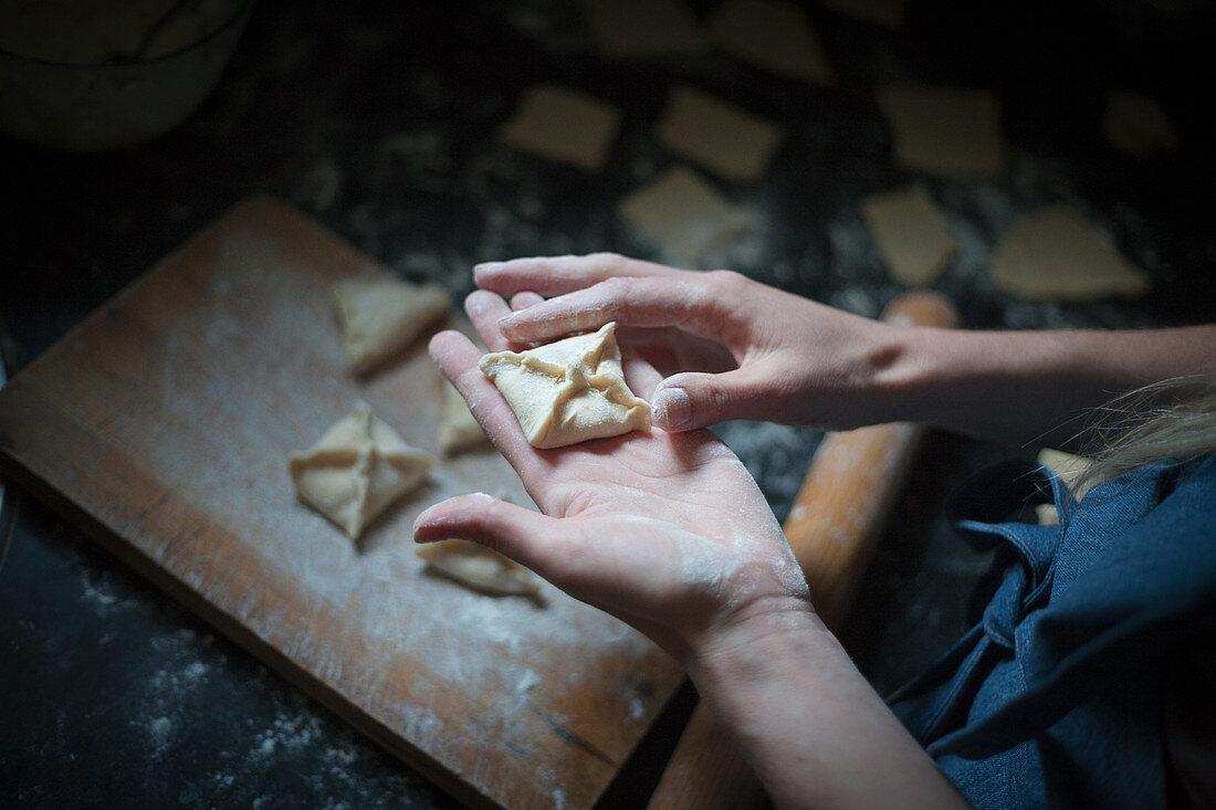 Preparing similar square dumplings with decoration