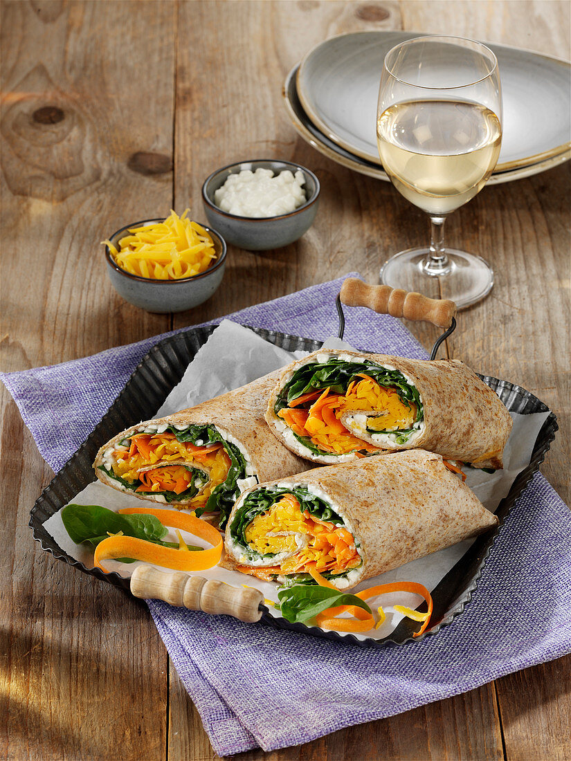 Colourful wraps with cream cheese and vegetables
