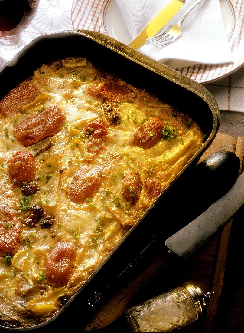 Turnip and tomato casserole with mince in the dish