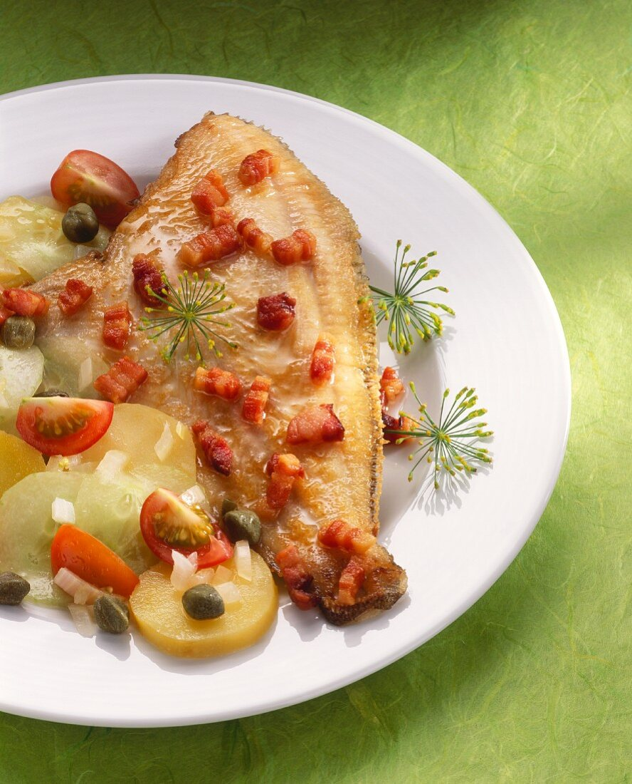 Flounder with bacon with potato salad on plate