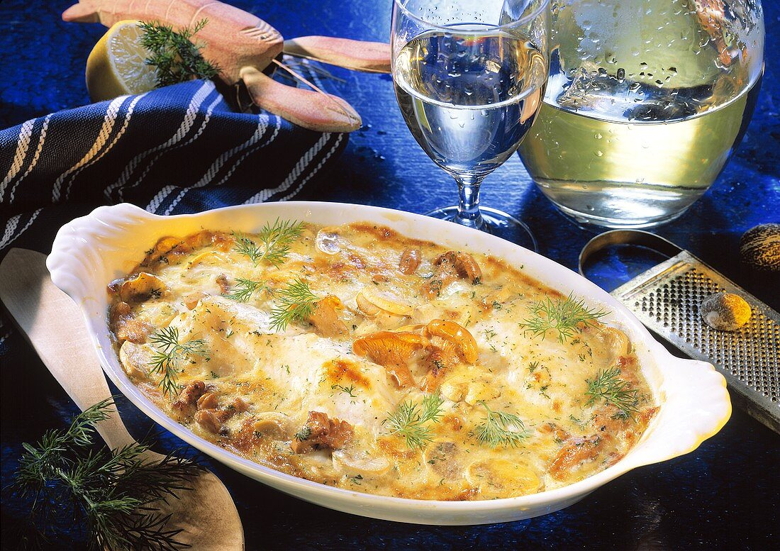 Red perch gratin with chanterelles in gratin dish