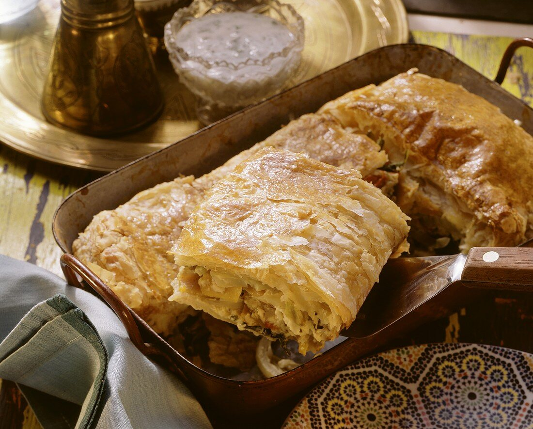 Arabic puff pastry vegetable pie in a roasting dish
