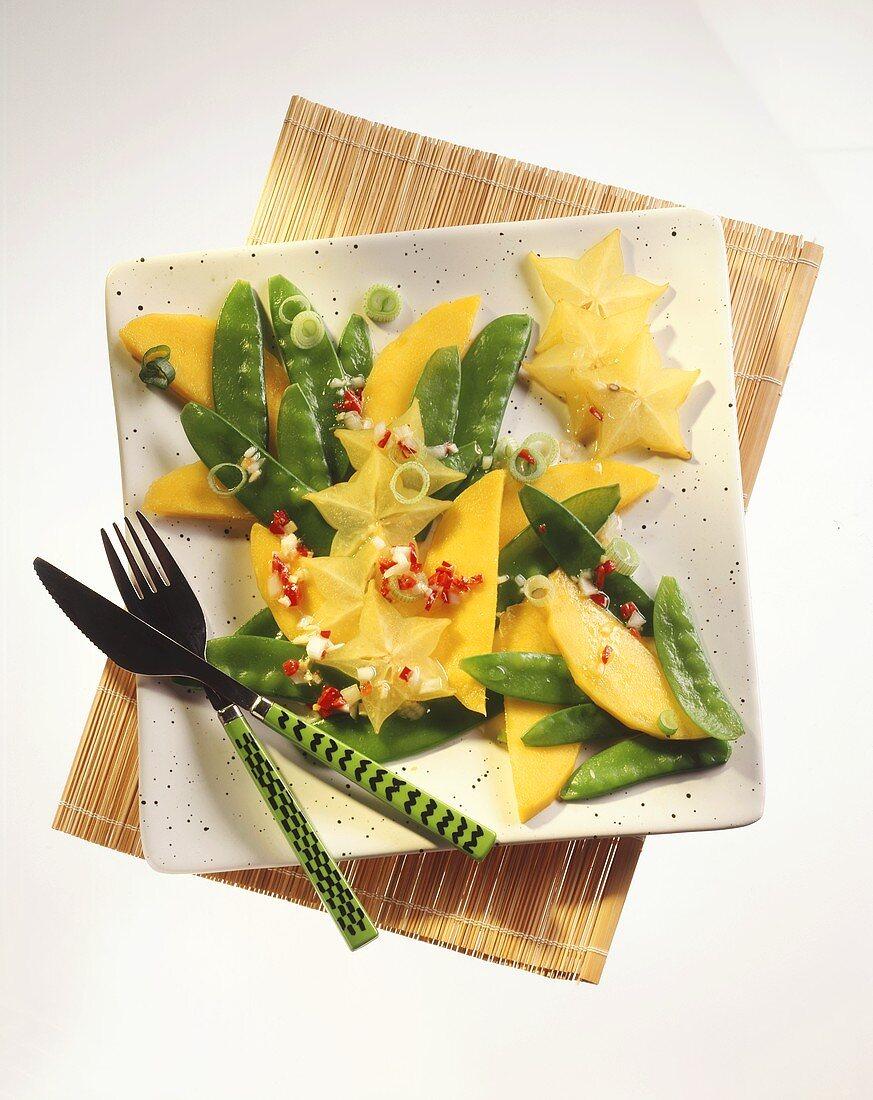 Mango & carambola salad with mangetouts, ginger-chili dressing