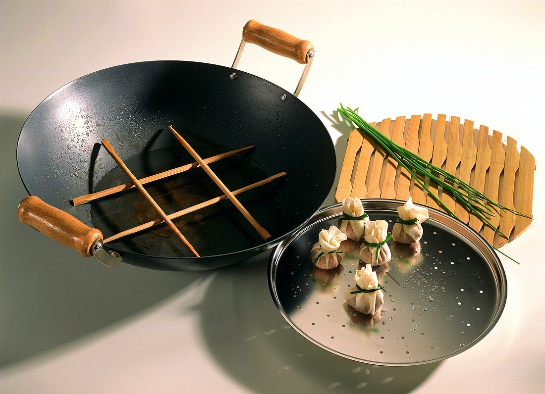 A Wok with assorted Utensils
