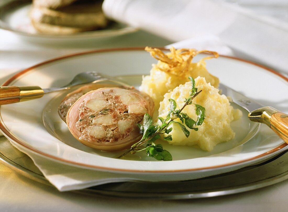 Stuffed pig's stomach with sauerkraut & mashed potato