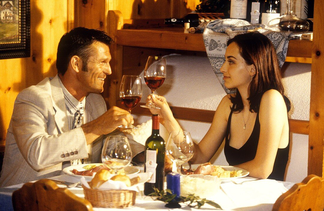 A Couple Toasting Red Wine