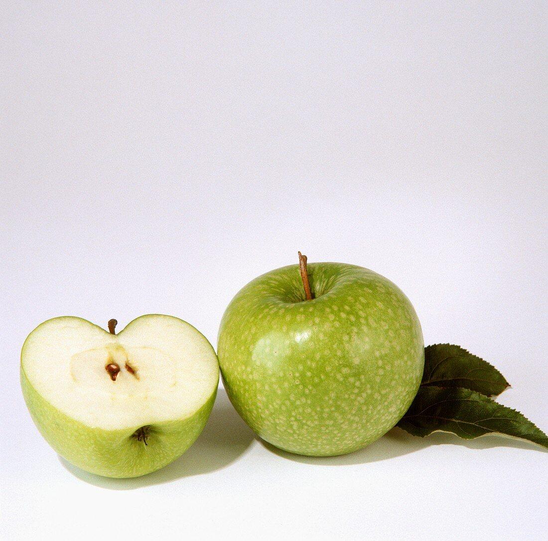Whole and half Granny Smith apple