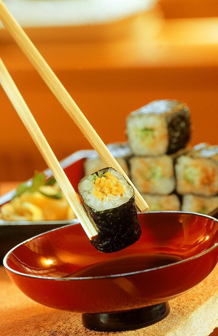 Maki-Sushi with Dipping Sauce in Red Bowl