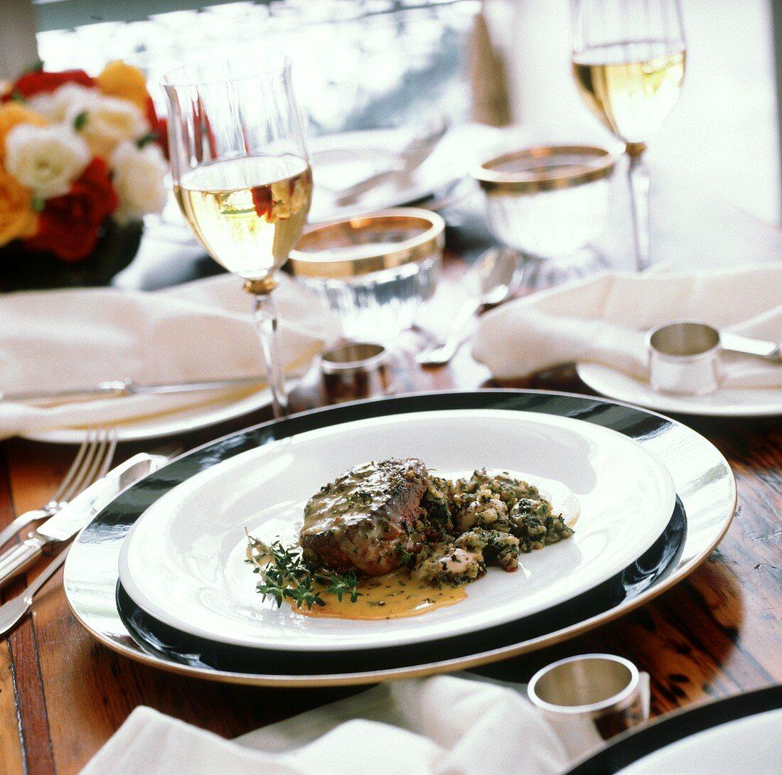 Kangaroo steak with tarragon sauce on plate