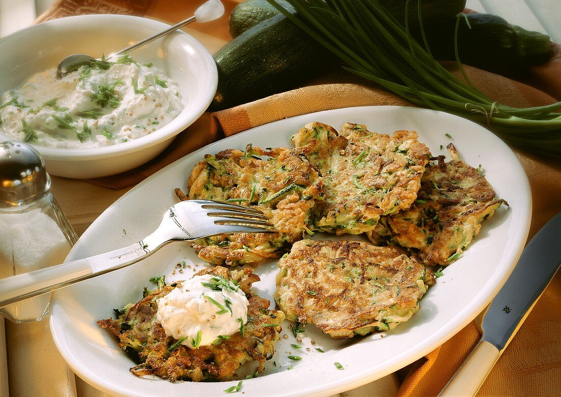 Courgette pancake on serving dish with herb sour cream