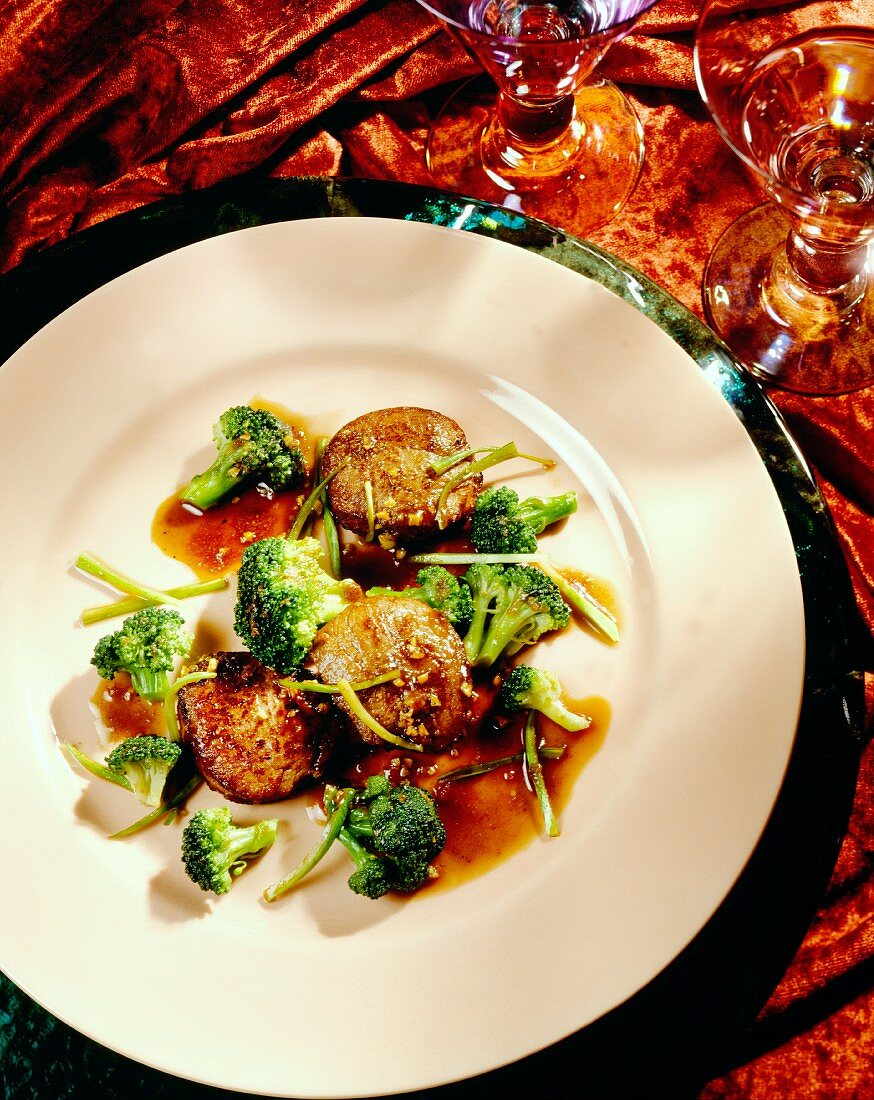 Pork fillets with peanut sauce and broccoli