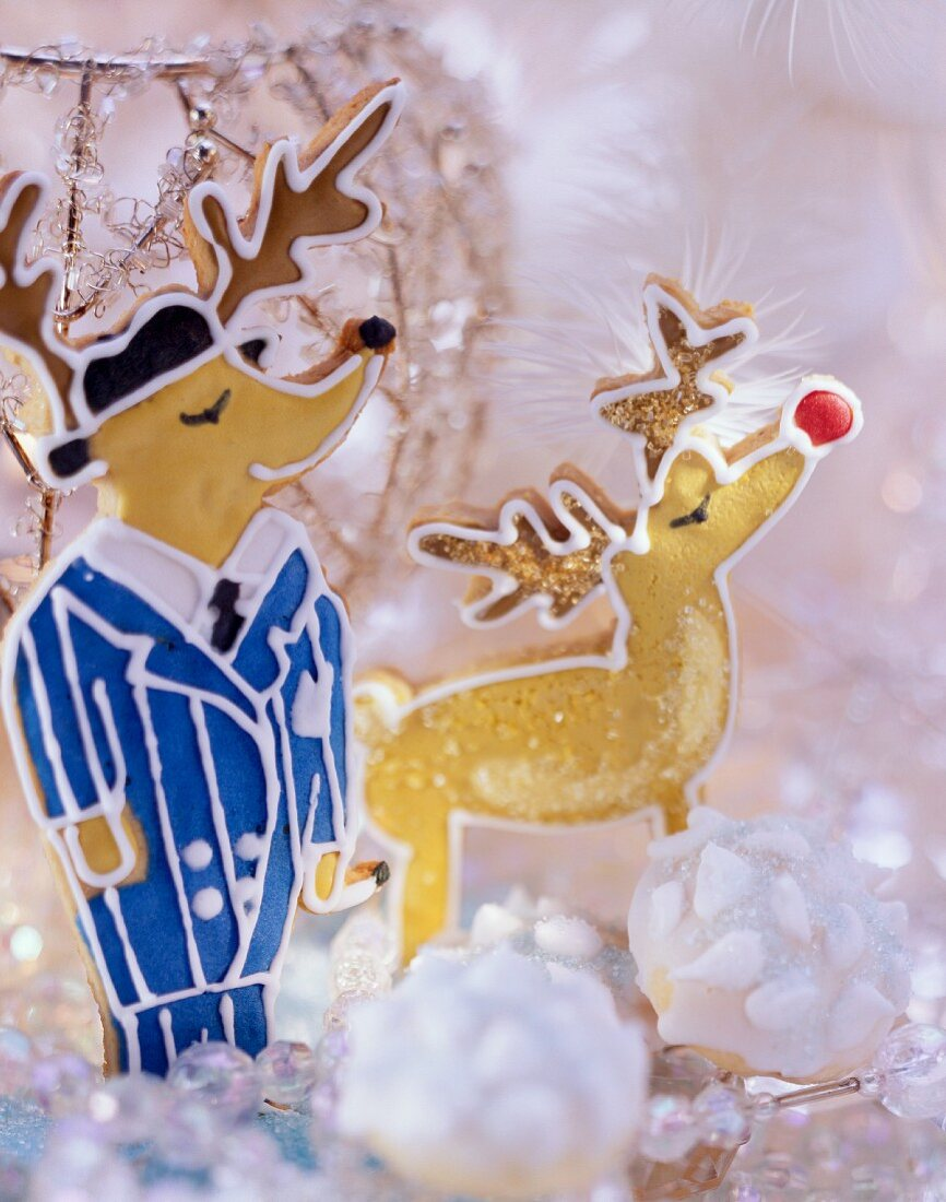 Two gingerbread reindeer with glittery winter decoration