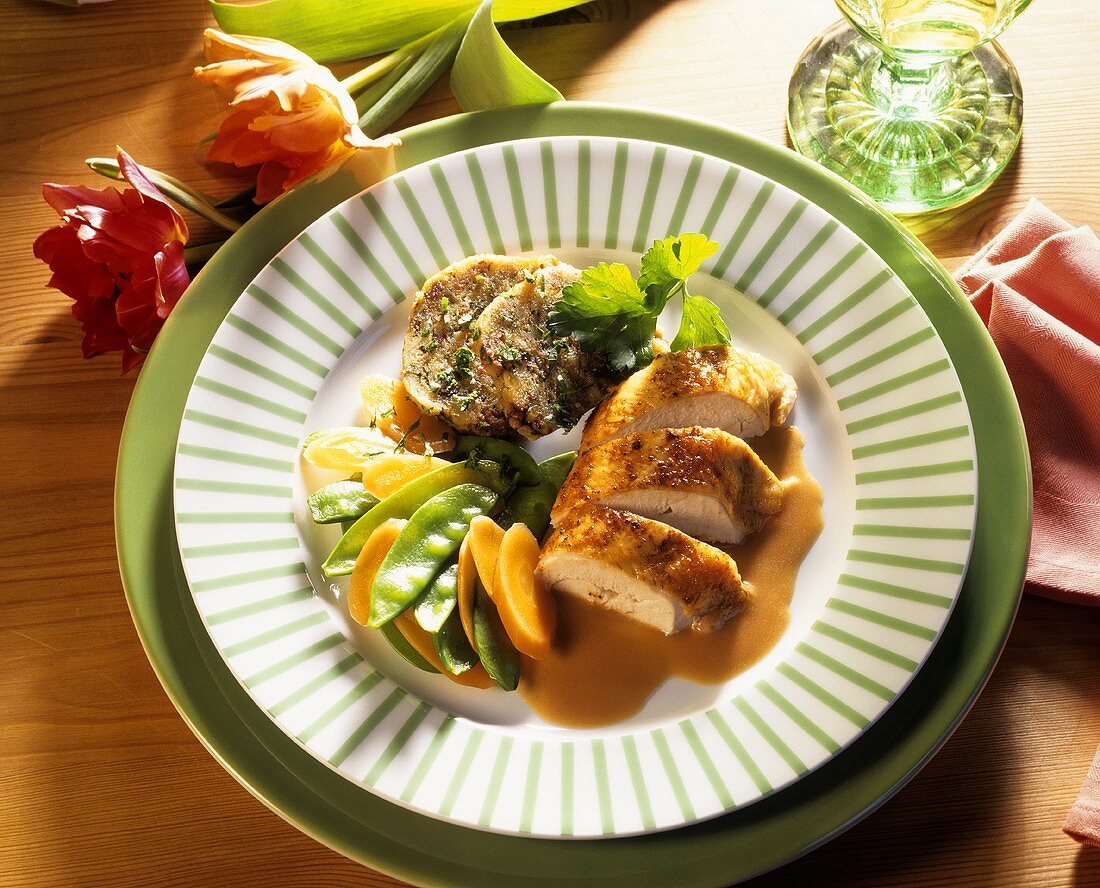 Chicken breast filet with bacon dumplings, mangetouts & carrots