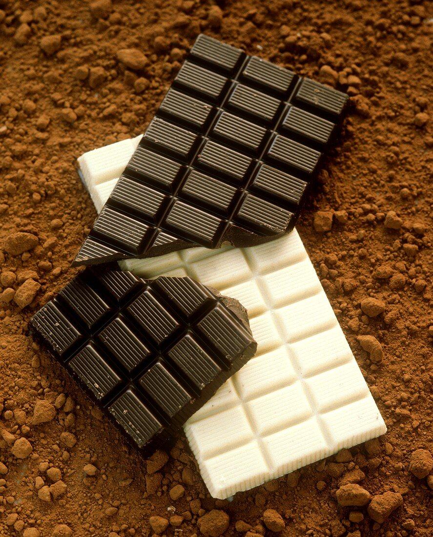 Blocks of Bittersweet Chocolate, White Chocolate Resting on Cocoa
